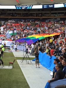 Southsiders whipping out Vision Vancouver's rainbow flag at the beginning of the game.